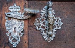 Door-handle decoration detail of old  entrance door in Prague Stock Photo