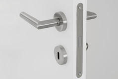 Door handle on door. Modern door handle on white open door Stock Photo