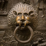 Door handle in the form of the lion head Royalty Free Stock Image
