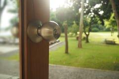 Door handle on garden view. Door handle on garden view background Royalty Free Stock Photos