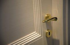 Door handle gold chrome door knob. Closeup Royalty Free Stock Image