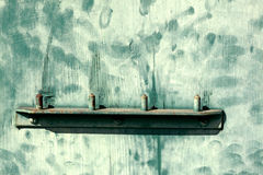 Door handle with green marked weathered pattern paint Royalty Free Stock Photos