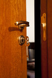 Door handle with inserted key stock photography