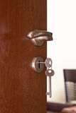 Door handle with inserted key Royalty Free Stock Photo