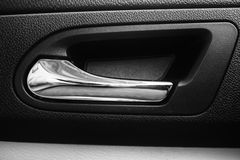 Door handle. Interior door handle of a vehicle in black and white Stock Photo