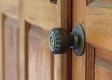 Door handle keyhole on brown wood door Royalty Free Stock Photos
