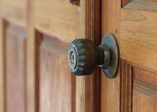 Door handle keyhole on brown wood door Royalty Free Stock Photos