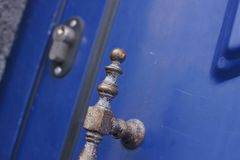 Door handle and keyhole. Of blue  door on Sao Miguel, Azores, Portugal Stock Photos