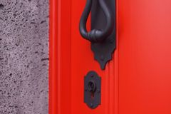 Door handle and keyhole. Of red door on Sao Miguel, Azores, Portugal Stock Image