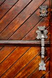 Door Handle and Lock. Ornate door handle and lock on a wooden door Stock Image