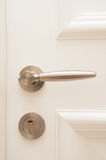 Door Handle and Lock. A portrait of wooden door handle with keyhole Stock Image