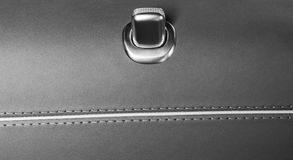 Door handle with lock control buttons of a luxury passenger car. Brown leather interior of the luxury modern car. Modern car inter. Ior details. Black and white royalty free stock images