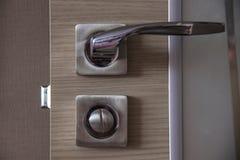 Door handle and lock on the door in the room close up. Stock Photo