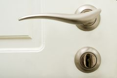 Door handle and lock with key Royalty Free Stock Image