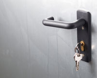 A door handle with lock and keys Stock Image