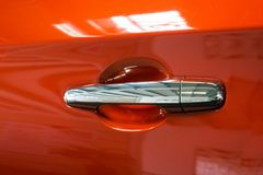 Door handle of a modern red car. Close-up. Detail.  stock images