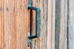 Door handle on obsolete wooden background Stock Image