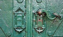 Door handle. Old green door with handle Royalty Free Stock Images