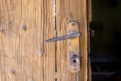 Door Handle. Old Door with Rusted Handle royalty free stock photo