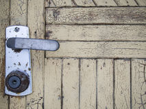 Door handle. Old style door handle on natural wooden door Royalty Free Stock Images