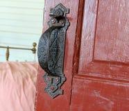 Door Handle. Ornate door handle on a  historic red wooden door Royalty Free Stock Images