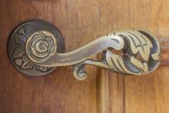 Door handle. Ornate metal door handle in outdoor royalty free stock photos