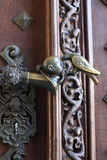 Door handle with a pigeon pecking a head. In the palace, Czech republic stock images