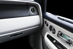 Door handle with power window control buttons of a luxury passenger car. White perforated leather interior with stitching and natu. Ral wood panel. Modern car stock photos