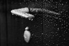 Door handle with rain drops. Door handle after rain with rain drops in black and white Stock Photography