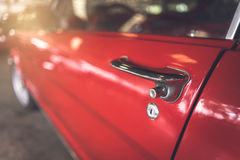 Door handle of red retro classic car Stock Image