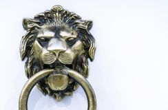 Door handle with a ring in the form of a lion`s head royalty free stock photography