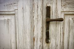 Door handle on rustic door