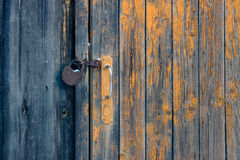 The door with handle and rusty padlock Royalty Free Stock Image
