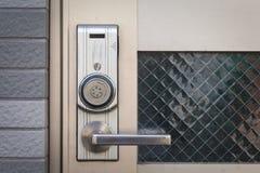 Door handle with security system lock on metal door Royalty Free Stock Photo