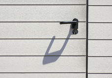 Door handle with shadow Royalty Free Stock Photography