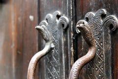 Door handle snake. Ancient metal royalty free stock images