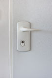 Door handle. White door handle of apartment Stock Photo