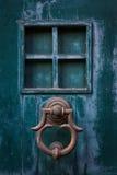 Door handle and the window Stock Photos