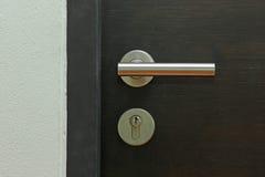 Door handle on wooden door Stock Photo