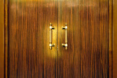 Door handle on the wooden doors Stock Photography