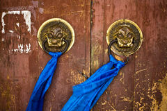 Door handles on ancient temple royalty free stock images