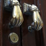 Door handles on the building in the old sea town of Cadiz. Royalty Free Stock Photo