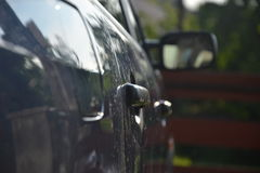 Door handles on the car.  Stock Image