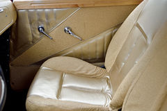 Door handles and chair in vintage car  Royalty Free Stock Image