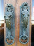 Door handles in the form of a lion`s head royalty free stock photo