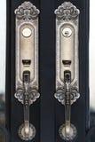 Door handles. Gold,and the door black Royalty Free Stock Photo