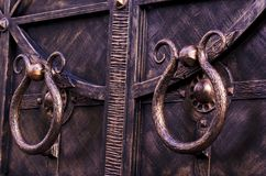 Door handles of metal gates. Decorative forging royalty free stock image