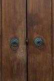 Door handles. Old door handles on wooden door Royalty Free Stock Photo
