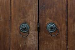 Door handles. Old door handles on wooden door Stock Photo