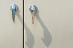 Door handles. Silver door handles on Electronic control box Stock Images